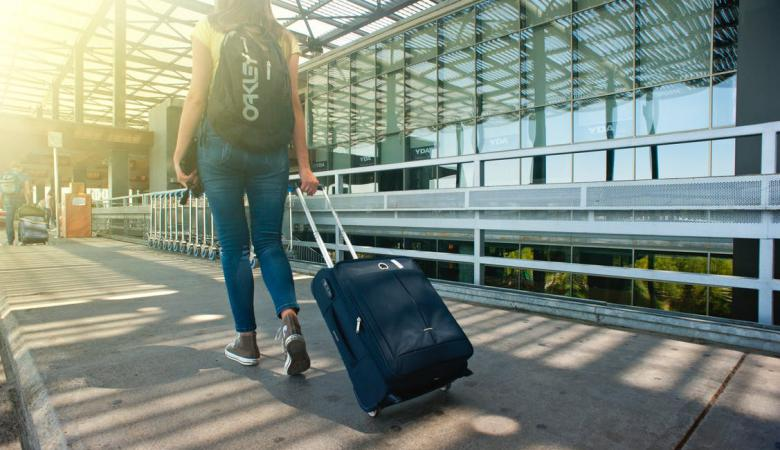 WOman Pulling Luggage at Airport | Airport Accident Claims