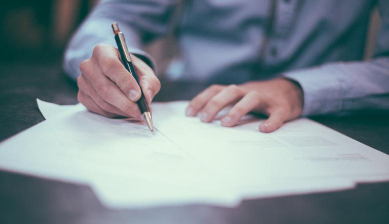 Signing a Document | Claims Myths